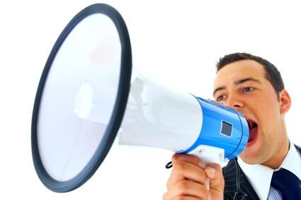 Portrait of a  man talking into a megaphone